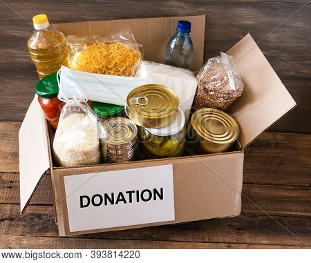 Cardboard Box With Oil, Canned Food, Cereals And Pasta.