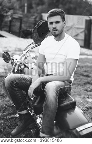 Young Motorcyclist Sitting On A Classic Motorcycle