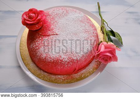 Red Cake Covered With Marzepan Or Mastic With A Flower, White Background, Lifestyle Background