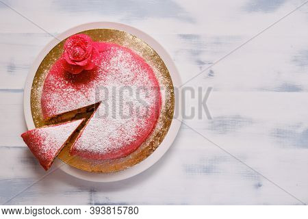 Red Cake Covered With Marzipan Or Mastic With A Cut Piece, Copy Space, Lifestyle Background