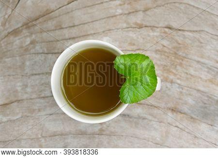 Tea Centella Asiatica, Asiatic Pennywort Hot Tea In A Glass On Wood Table And Got Centella Asiatica