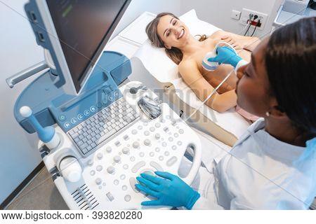Preemptive ultrasound mammography done by gynecologist on modern machine