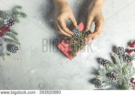 Woman Wrapping Christmas Presents. Christmas Gift. Congratulations.top View Of Woman Holding Traditi