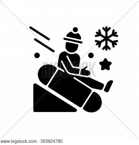 Snow Tubing Black Glyph Icon. Fun Children Ride Downhill. Extreme Sledging. Winter Activity. Festive