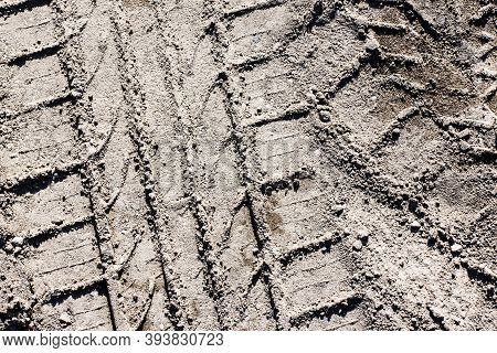 Mud Tyre Mark Background. Dry Sand Tire Print Texture. Car Trail Track Pattern. Sandy Road Wheel Lin