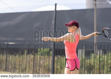 Pretty Sportswoman With Racquet At The Tennis Court. Healthy Lifestyle