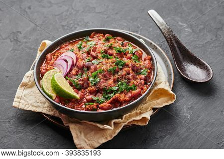 Rajma Masala Curry In Black Bowl On Dark Slate Table Top. Red Kidney Bean Dal Is Indian Cuisine Vege