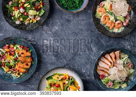Asian Salads With Copy Space In Center. Menu, Cuisine, Kitchen Concept. Asian Food Served, Top View,
