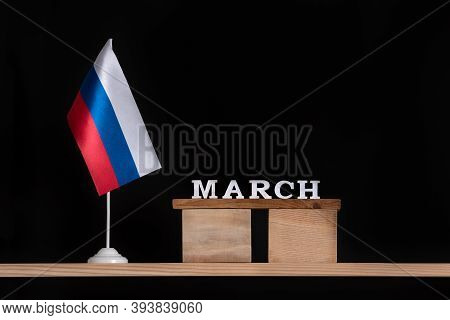 Wooden Calendar Of March With Russian Flag On Black Background. Dates In Russia In March.