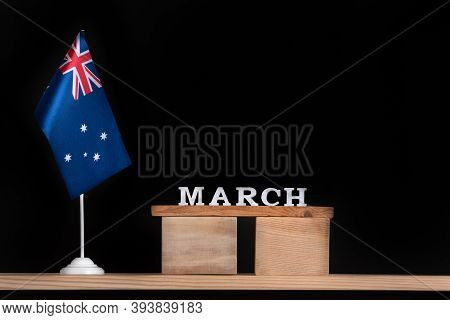 Wooden Calendar Of March With Australian Flag On Black Background. Holidays Of Australia In March.