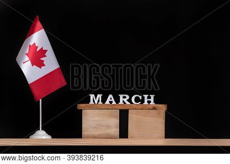 Wooden Calendar Of March With Canadian Flag On Black Background. Holidays Of Canada In March.