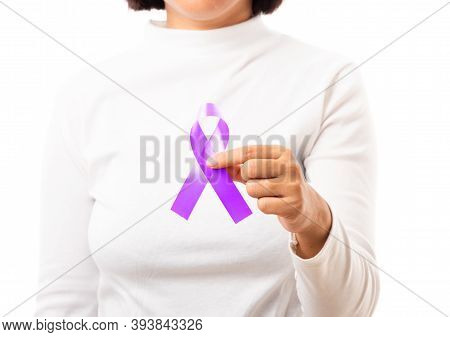 National Epilepsy Or Alzheimer Disease Day. Young Woman Holding Purple Ribbon On Hand Symbol Of Panc
