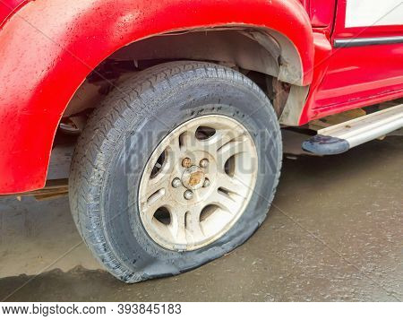 Soft And Selective Focus Of Damaged And Deflated Flat Tires Of An Old Car. Concept Of Punctures And