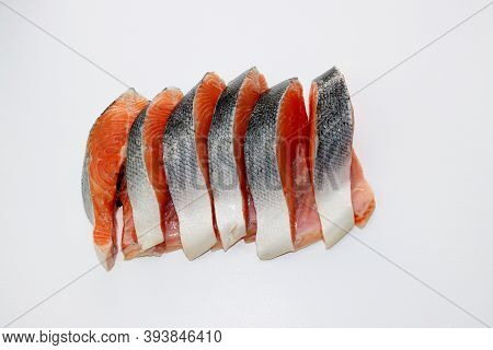 Six Large And Fatty Salmon Steaks On A White Background.
