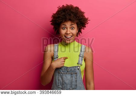 Joyful Surprised African American Woman Indicates At Herself, Asks Really Me, Has Positive Expressio