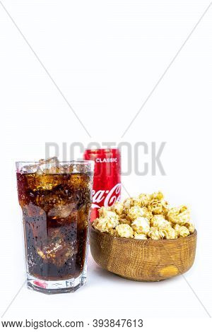 Glass Of Cold Refreshing Coca Cola Soda With Ice, Metal Can Of Coca Cola Classic, Wooden Bowl Of Fre