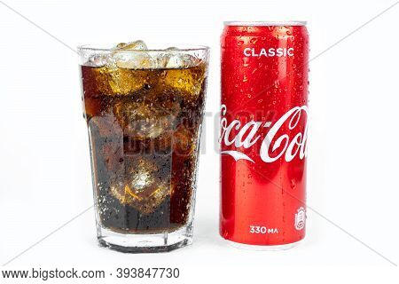 Glass Of Cold Refreshing Coca Cola Soda With Ice, Metal Can Of Coca Cola Classic, Isolated On White