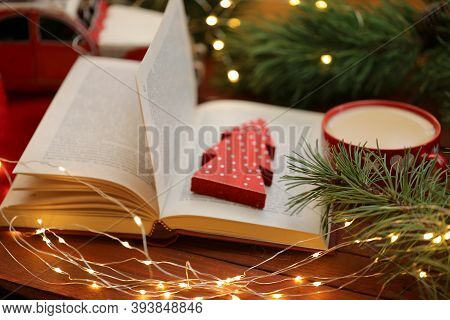 Winter Cozy Reading. Books About Christmas. Open Book With Decorative Red Christmas Tree, Coffee Mug