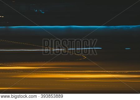 Long Exposure Blue Yellow Light Painting Photography, Ripples And Lines Against Black Background. Vi