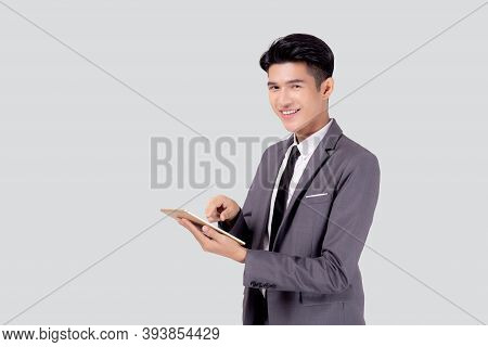Portrait Young Asian Business Man In Suit Standing Using Tablet Computer To Internet Isolated On Whi