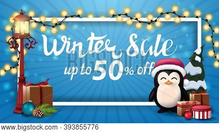 Winter Sale, Up To 50 Off, Blue Discount Banner With White Frame Wrapped With Garland, Old Pole Lant