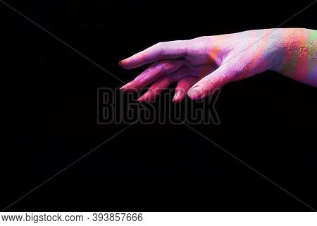 A Beautiful Female Multicoloured Hand Wants To Take Something On A Black Isolated Background, Banner