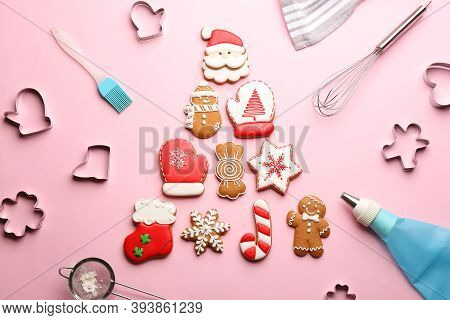 Christmas Tree Made Of Delicious Gingerbread Cookies Surrounded By Kitchen Utensils On Pink Backgrou