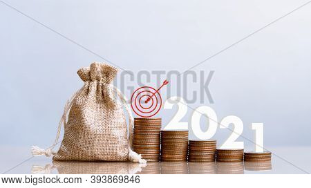 2021 And Coins In Sack With Small Plant Tree. Pension Fund, 401k, Passive Income. Investment And Ret