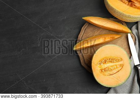 Tasty Fresh Melons On Black Slate Table, Flat Lay. Space For Text