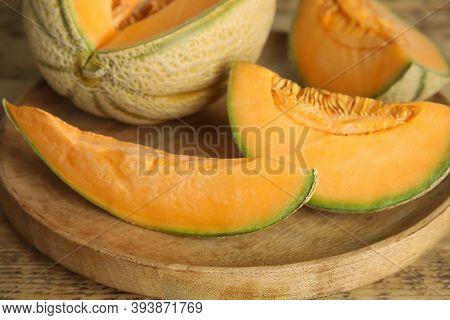 Tasty Fresh Cut Melons On Wooden Tray, Closeup