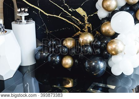 Close Up Of Birthday Photozone With Colors Balloons. Black White And Gold Decorations For The Celebr