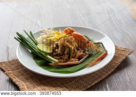 Pad Thai With Fresh Shrimp On A Wooden Table Pad Thai Is A Delicious Thai Street Food. And Popular P