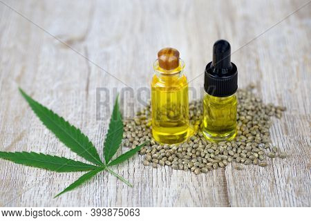Glass Bottles Containing Hemp Oil, Cbd And Medicine Extracted From Hemp Oil. Concept Medical Options
