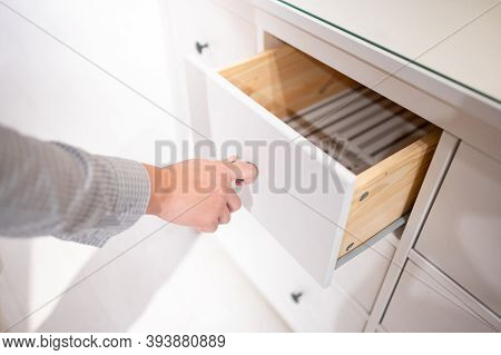 Male Hand Pulling And Opening Drawer On White Wooden Cabinet. Home Furniture And Decoration Shopping