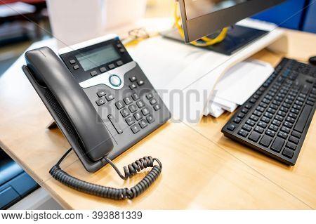 Call Center And Customer Service Help Desk. Landline Telephone And Desktop Computer On Working Desk