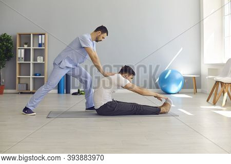 Osteopath Stretching Man Patients Back And Making Rehabilitation Theapy For Patient