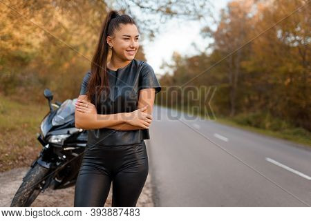Portrait Of Female Motorcyclist On The Road