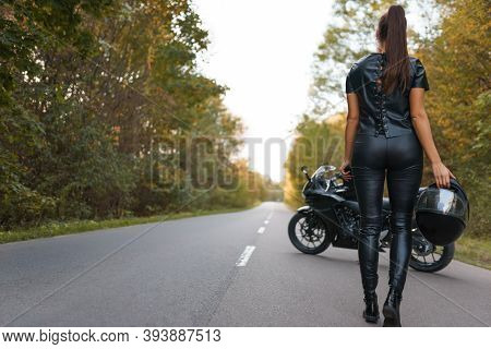 Brutal Female Motorcyclist Stands On The Road