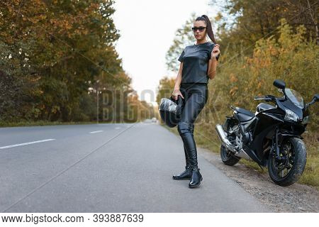 Stylish Female Motorcyclist On The Road. Sport Girl