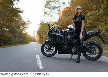 Stylish Female Motorcyclist On The Road. Moto Hobby