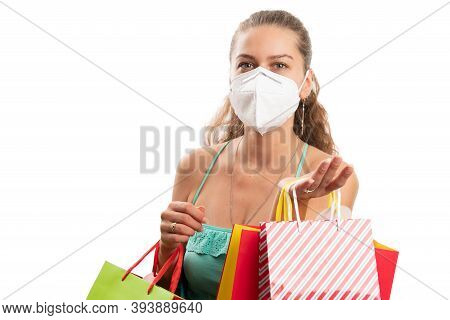 Adult Female Model Carrying Shopping Bags Colourful Wearing Disposable Medical Or Surgical Mask To P