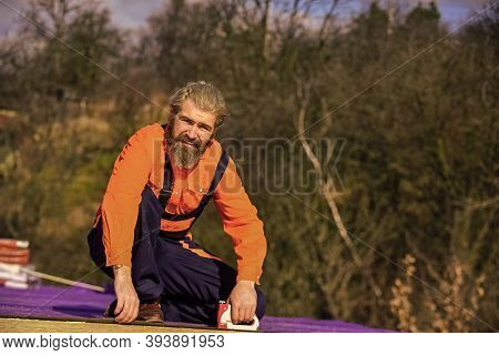 Roof Installation. Bearded Man Work Outdoor. Roof Mechanic Concept. Inspect Repair And Replace. Asse