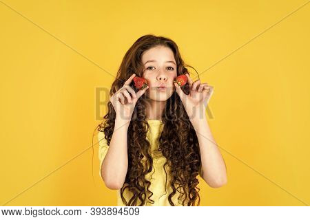 Playful Kid. Healthy Breakfast. Healthy Food. Health Care. Child Eating Strawberry. Dessert Sweet Fo