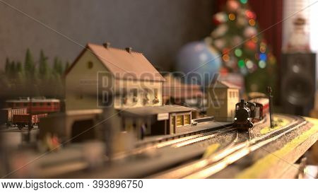 Toy Train Model On A Town Railway. Western Setting And Christmas.