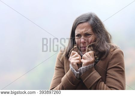 Stressed Middle Age Woman Getting Cold Grabbing Jacket Complaining In Winter Standing Outdoors