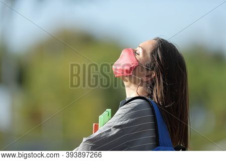 Profile Of Student With Protective Mask Breathing Fresh Air Avoiding Coronavirus Contagion In A Park