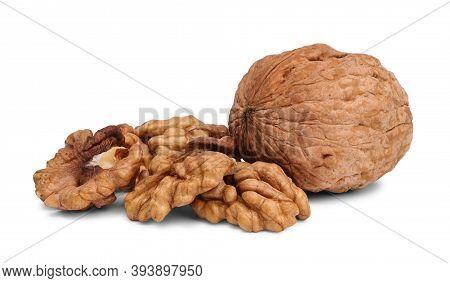 Close Up Of Hard Walnut And Heap Of Walnut Kernels, Isolated On White Background.