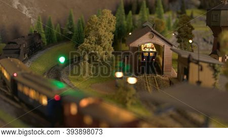 Train Shed On A Railway Model. Retro Miniature Model Of Train In A Countryside.