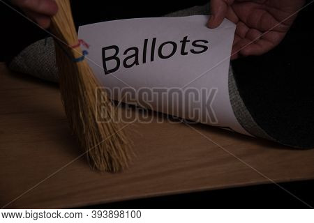Sweeping Hand Broom Showing Movement Toward A Rug Or Carpet Where The Word Ballot Is Being Swept Und