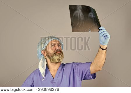 Doctor Examines Radiographical Snapshot. X-raying Of Hands. Nurse Checking X-ray Film At Hospital. H